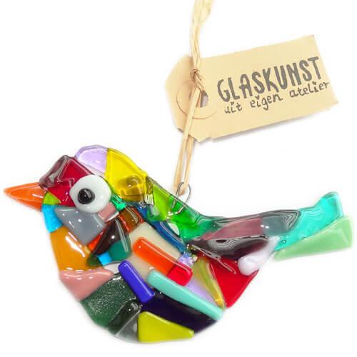 Glazen vogels van gekleurd glas