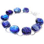 Unieke blauwe armband met RVS en glazen cabochons