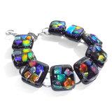 Exclusieve RVS edelstaal armband met gekleurde glazen kunstwerkjes. Een glasfusing armband met alle kleuren van de regenboog.