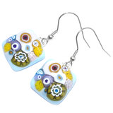 Lange lichtblauwe oorbellen met gele en paarse Millefiori figuren!