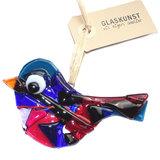 Glazen vogel van rood, blauw en paars glas om op te hangen in huis of tuin