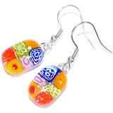 Handgemaakte gekleurde oorbellen met kleurrijke millefiori bloemen!