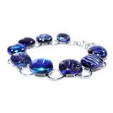 Blauwe armband handgemaakt van RVS met speciaal glas