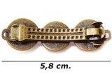 Achterkant bronskleurige haarknip