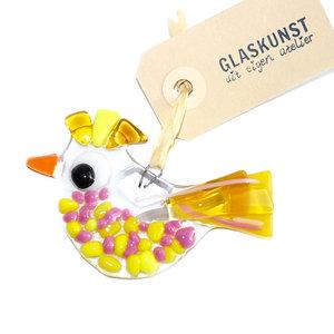 Glazen vogeltje van helder glas met mooie gele en roze accenten. Glaskunst decoratie voor huis en tuin!