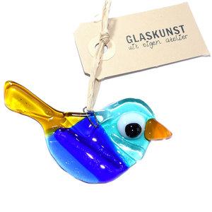 Kleine glazen vogel handgemaakt van helder blauw en geel glas.