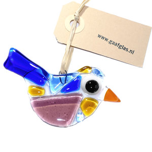 Kleine glazen vogel handgemaakt van helder glas met blauw, paars en gele accenten.