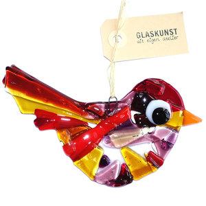 Gekleurde glazen vogel hanger gemaakt van paars, rood en amber geel glas.