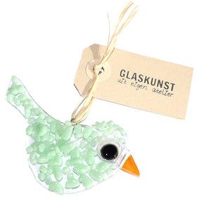 Kleine glazen vogel handgemaakt van helder glas met mintgroene accenten.