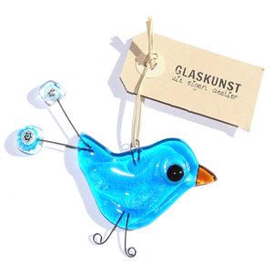 Blauwe vogel hanger van helder glas met blauwe millefiori bloemen.