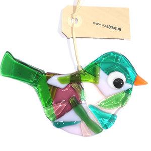 Glazen vogel hanger van helder groen glas gecombineerd met paars en roze kleuren.