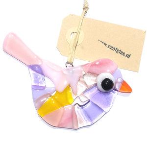 Prachtige lila, geel en roze gekleurde vogelhanger van glas. Glazen vogel hanger van speciaal glas