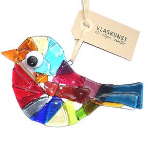 Grote heldere glazen vogel handgemaakt van speciaal glas in alle kleuren van de regenboog.