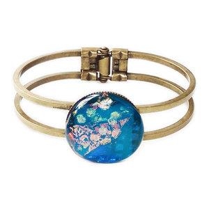 Bronskleurige armband met prachtige blauwe glazen cabochon!