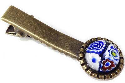 Bronskleurig haarknipje met een vier blauwe bloemen