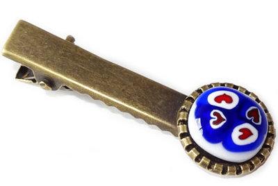 Bronskleurig haarknipje met blauw-rood-witte hartjes!