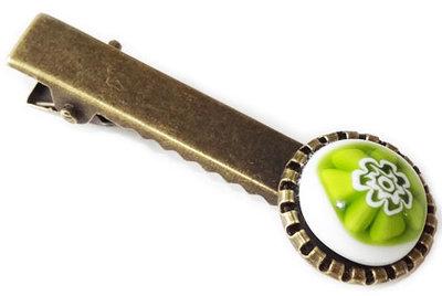 Bronskleurig haarknipje met een wit-groene bloem!