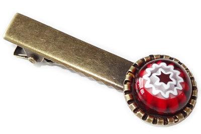Bronskleurig haarknipje met rood-witte ster/bloem van millefiori