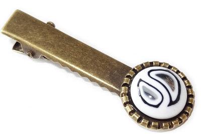 Bronskleurig haarknipje met zwart-witte glazen cabochon!