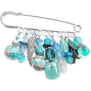 Handgemaakte grote speld/broche met allerlei turquoise en blauwe glaskralen!
