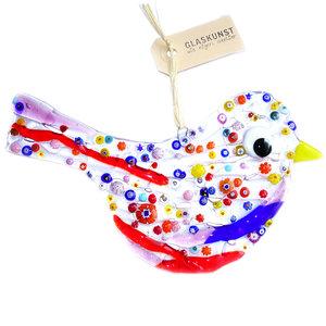 Grote glazen vogel van helder glas met rode, paarse en blauwe accenten en fraaie kleurrijke millefiori figuren in het glas. Dec