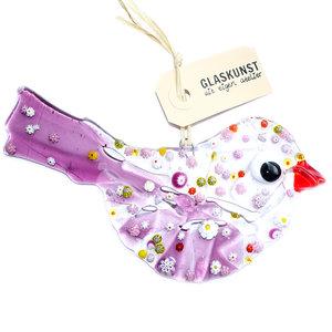 Glazen vogel van helder glas met rode en paarse accenten en fraaie millefiori figuren in paars, roze, wit en gele tinten.