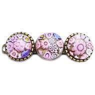 Handgemaakte roze haarspeld met schattige roze millefiori bloemen van glas.