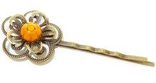 Haarschuifje met handgemaakte oranje glazen bloem!